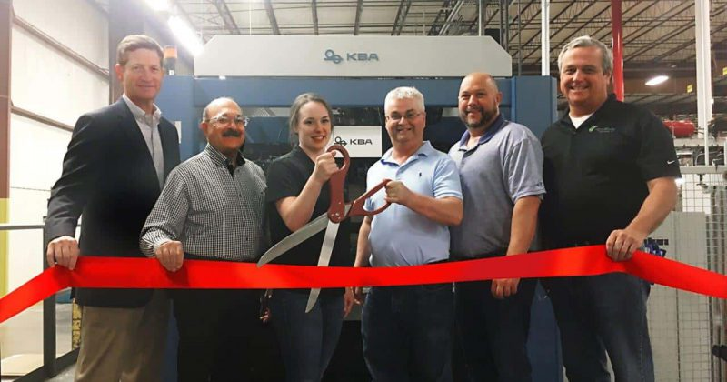 Baldwinsville KBA Ribbon 6 people cutting ribbon