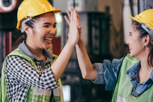 Workers high fiving